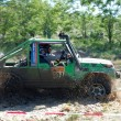 Suzuki SJ jeep at offroad rally competition - Stock Photo