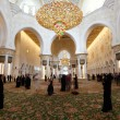 Stock Photo: Visitors inside of Sheikh Zayed Mosque in Abu Dhabi