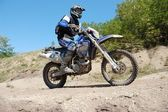 Enduro rider at motocross competition — Stock Photo