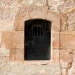 Closed metal door in an ancient fortress, Barcelona Spain — Stock Photo