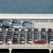 New cars parked at port — Stockfoto