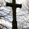 Cross at a graveyard — Stock Photo