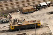 Aerial view of electric locomotive at freight depot — Photo