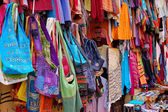 Bags and clothes at an oriental market in Granada, Spain — Stock Photo