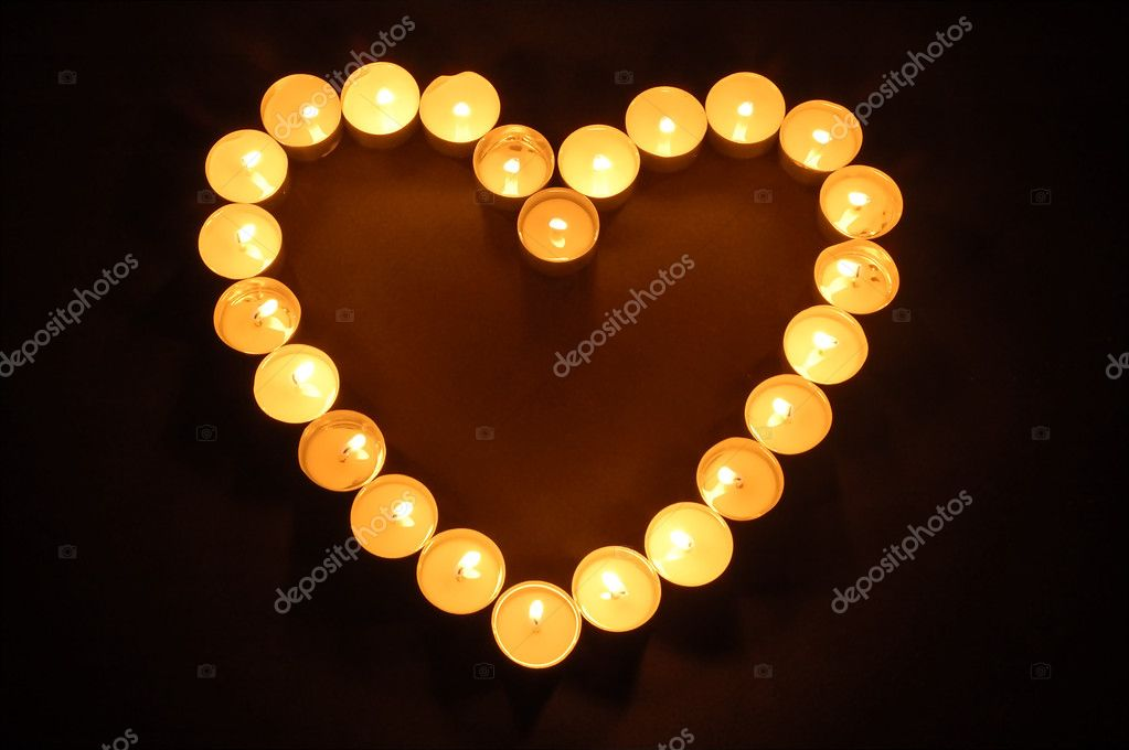 Candles heart shaped  Zdjcie stockowe #9875344