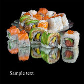 Set of japanese sushi on black background — Stock Photo