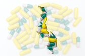 Outline map of malawi with pills in the background for health an — Stock Photo