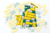 Outline map of mauritania with pills in the background for healt — Stock Photo