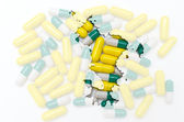 Outline map of mayotte with pills in the background for health a — Stock Photo