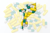 Outline map of mozambique with pills in the background for healt — Stock Photo