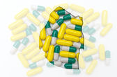 Outline map of swaziland with pills in the background for health — Stock Photo