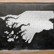 Stock Photo: Outline map of guinebissau on blackboard