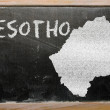 图库照片: Outline map of lesotho on blackboard