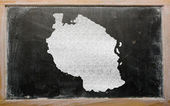 Outline map of tanzania on blackboard — Stock Photo