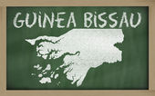 Outline map of guinea bissau on blackboard — Stock Photo