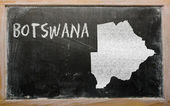 Outline map of botswana on blackboard — Stock Photo