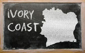 Outline map of ivory coast on blackboard — Stock Photo