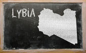 Outline map of lybia on blackboard — Stock Photo