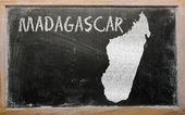 Outline map of madagascar on blackboard — Stock Photo
