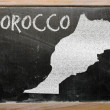 Outline map of morocco on blackboard — Stock Photo