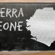 Stock Photo: Outline map of sierrleone on blackboard