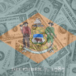 US state of delaware flag with transparent dollar banknotes in b — Stock Photo