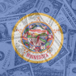 US state of minnesota flag with transparent dollar banknotes in — Stock Photo