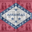 US state of arkansas flag with transparent dollar banknotes in b - Stock Photo