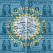 US state of south dakota flag with transparent dollar banknotes — Stock Photo