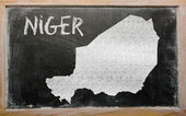 Outline map of niger on blackboard — Stock fotografie