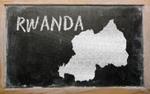 Outline map of rwanda on blackboard — Zdjęcie stockowe