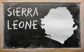 Outline map of sierra leone on blackboard — Stok fotoğraf