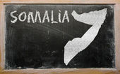 Outline map of somalia on blackboard — Stock Photo
