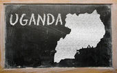 Outline map of uganda on blackboard — Zdjęcie stockowe