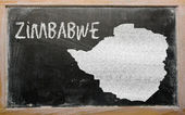 Outline map of zimbabwe on blackboard — 图库照片