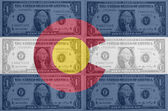 US state of colorado flag with transparent dollar banknotes in b — Stock Photo