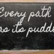 Expression -  Every path has its puddle - written on a school bl — Foto de Stock