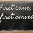 Expression - First come, first served  - written on a school bla — Stok fotoğraf