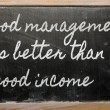 Stock Photo: Expression - Good management is better than good income - writt