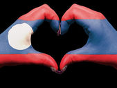 Heart and love gesture by hands colored in laos flag for touris — Stock fotografie