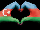 Heart and love gesture by hands colored in azerbaijan flag for t — Stock Photo