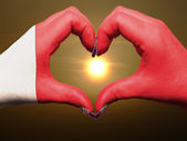 Heart and love gesture by hands colored in bahrain flag during b — Stock Photo