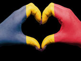 Heart and love gesture by hands colored in chad flag for touris — Stok fotoğraf