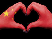 Heart and love gesture by hands colored in china flag for touris — Stok fotoğraf