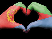Heart and love gesture by hands colored in eritrea flag for tou — Stock Photo