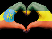 Heart and love gesture by hands colored in ethiopia flag for tou — Stock Photo
