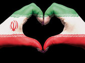 Heart and love gesture by hands colored in iran flag for touris — Stock fotografie
