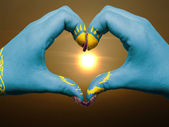 Heart and love gesture by hands colored in kazakhstan flag durin — Stock Photo