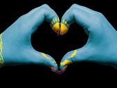 Heart and love gesture by hands colored in kazakhstan flag for t — Stock Photo