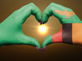 Heart and love gesture by hands colored in zambia flag during be — Stock Photo